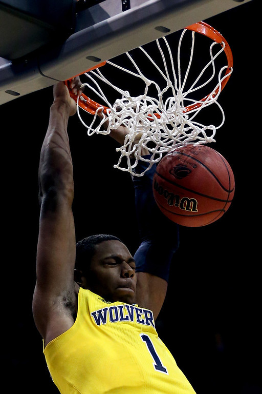 . Glenn Robinson III #1 of the Michigan Wolverines dunks the ball in the first half against the Texas Longhorns during the third round of the 2014 NCAA Men\'s Basketball Tournament at BMO Harris Bradley Center on March 22, 2014 in Milwaukee, Wisconsin.  (Photo by Jonathan Daniel/Getty Images)