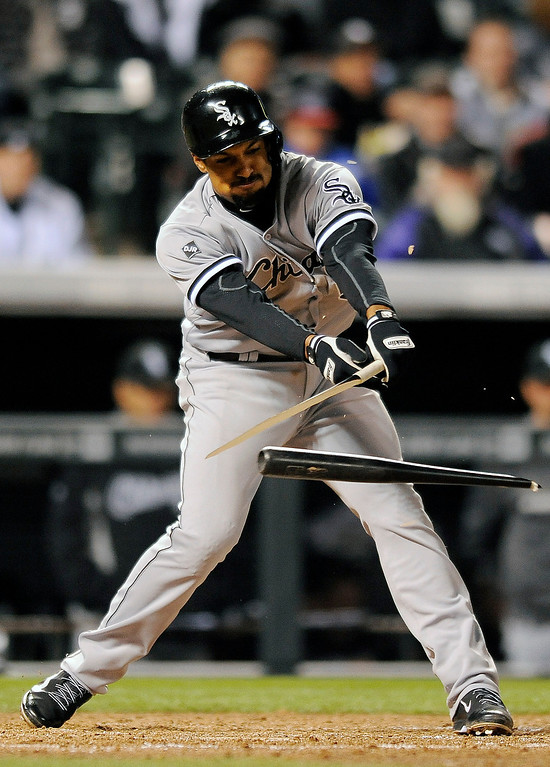 . Chicago White Sox Marcus Semien breaks his bat on a groundout in the sixth inning of the MLB baseball game against the Colorado Rockies on Monday, April 7, 2014, in Denver.(AP Photo/Chris Schneider)