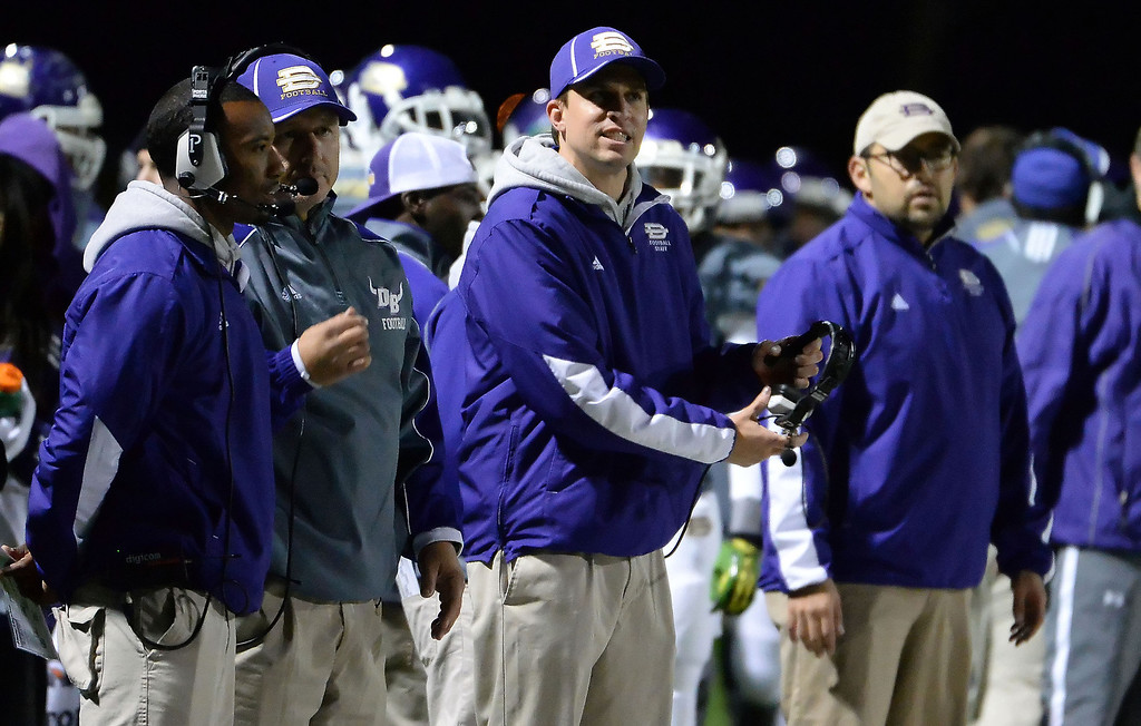 . Diamond Bar head coach Ryan Maine, center, reacts La Serna\'s Frankie Palmer (not pictured) scrambles for a first down in the first half of a CIF-SS playoff football game at Diamond Bar High School in Diamond Bar, Calif., on Friday, Nov. 22, 2013.   (Keith Birmingham Pasadena Star-News)