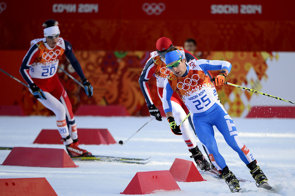 . Italy\'s Alessandro Pittin (25) competes in the Nordic Combined Individual NH / 10 km Cross-Country at the RusSki Gorki Jumping Center during the Sochi Winter Olympics on February 12, 2014, in Rosa Khutor near Sochi. Left is bronze winner Norway\'s Magnus Krog.   AFP PHOTO / PIERRE-PHILIPPE  MARCOU/AFP/Getty Images