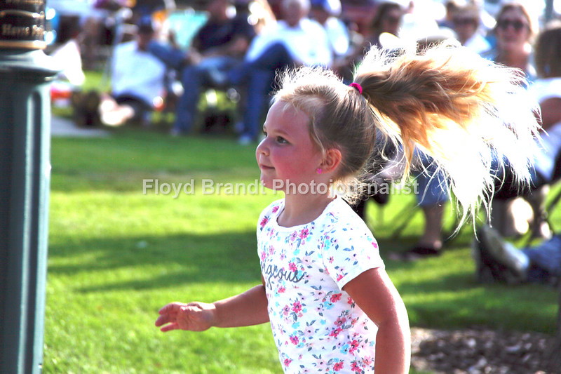 Havre Daily News / Floyd Brandt   Filled with people listening to the music of Swamp Goat at Town Square Park four year old Alivia Bradley dances to the music of Sounds on the Square Wednesday