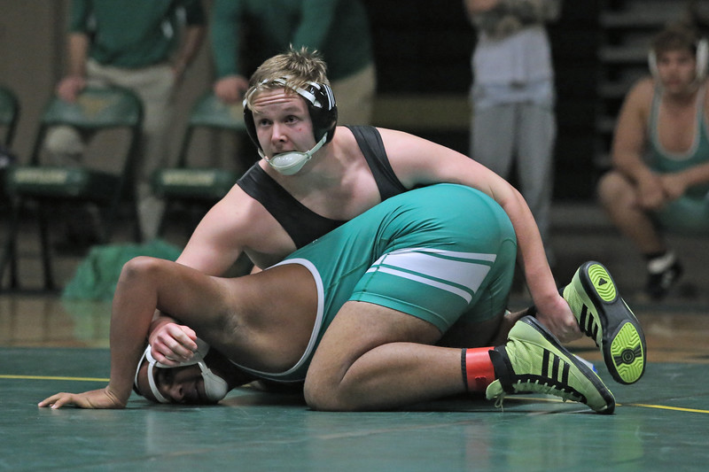 Darian Newcomb of Brick takes on Andrew Zahlmann of Brick Memorial during their 220 lb bout as Brick Memorial High School hosted Brick Township High School for a boys varsity wrestling match on Tuesday Jan. 8,2019 (MARK R. SULLIVAN /THE OCEAN STAR)