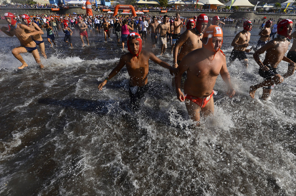 ". Approximately 370 lifeguard aspirants participate in the 49th ""El Paso del Hombre\"" aquatic marathon, in the port of La Libertad, 35 km from San Salvador, El Salvador on february 24, 2013. The main aim of this traditional physical test is to prepare lifeguards to serve during the holiday season in El Salvador. Marvin Recinos/AFP/Getty Images"