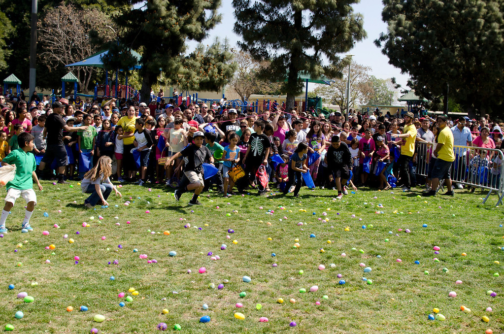 . A crowd of children run into the field at Easter Land at Mayberry Park in South Whittier, Calif. Saturday, March 20, 2013. An expected crowd of 2,000 guest more than doubled for a helicopter drop of 5,000 Easter eggs. (SGVN/Correspondent photo by Anibal Ortiz)