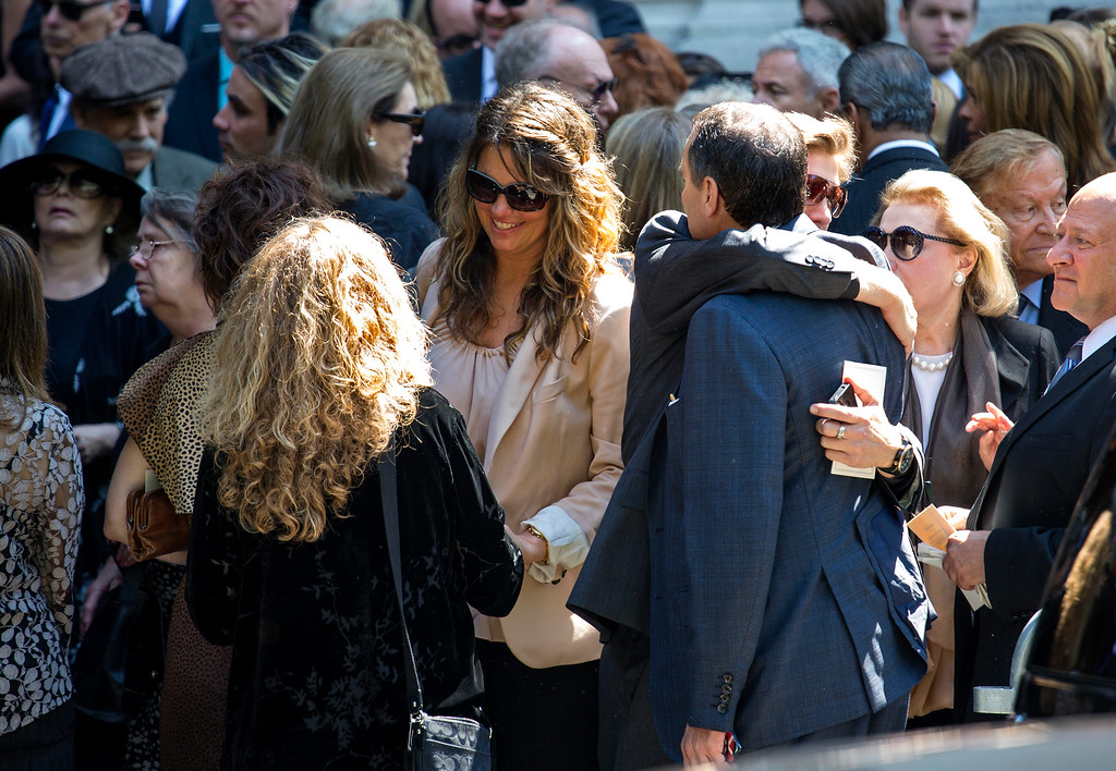 . Attendees gather after a funeral service for comedian Joan Rivers at Temple Emanu-El in New York Sunday, Sept. 7, 2014. Rivers died Thursday at 81. (AP Photo/Craig Ruttle)