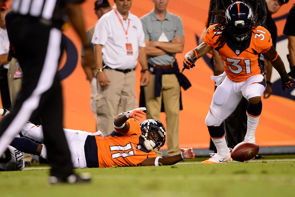 . DENVER, CO - AUGUST 24: Trindon Holliday (11) of the Denver Broncos loses control of a punt during the second half of action of an NFL preseason game at Sports Authority Field at Mile High on August 24, 2013. This is the third game of the preseason for the Broncos. (Photo by AAron Ontiveroz/The Denver Post)
