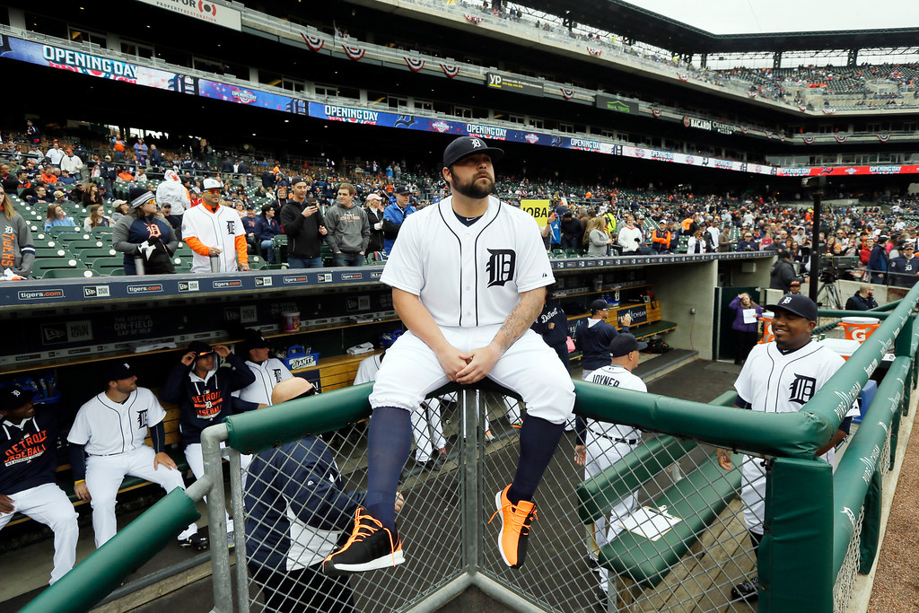 . Detroit Tigers relief pitcher Joba Chamberlain sits on the dugout railing before an opening day baseball game against the Minnesota Twins in Detroit, Monday, April 6, 2015. (AP Photo/Carlos Osorio)