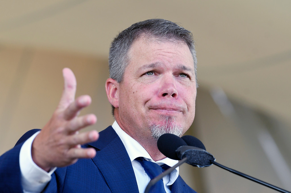 . National Baseball Hall of Fame inductee Chipper Jones gestures while speaking during an induction ceremony at the Clark Sports Center on Sunday, July 29, 2018, in Cooperstown, N.Y. (AP Photo/Hans Pennink)
