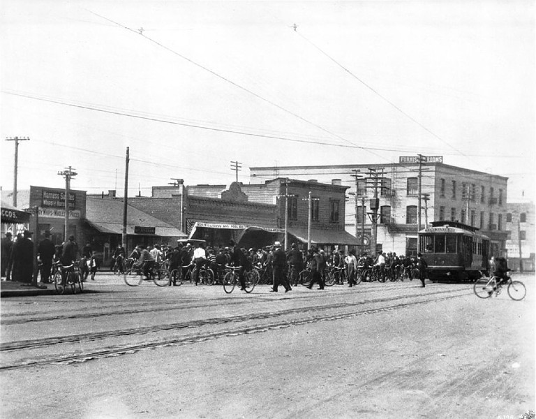 A bicycle parade for Griffith Park on Main Street at Ninth Street, Los Angeles, 1904