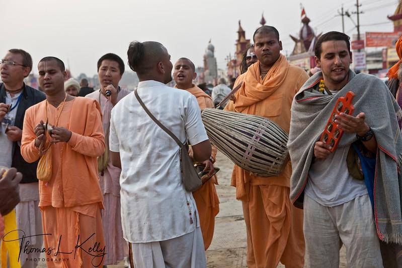 "Ishkon, the follower of Lord Krishna, sing to His name ""Harey Ram Harey Krishna"" as they parade through Kumbha mela ground. Allahabad, India."