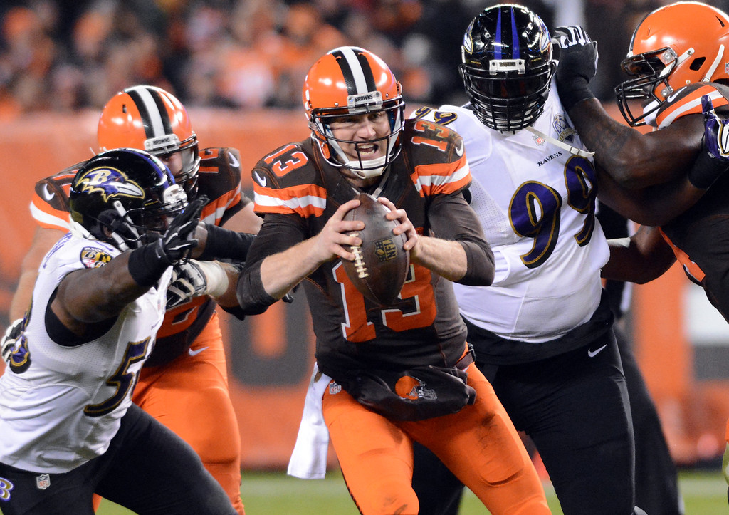 . News-Herald file Cleveland Browns quarterbck Josh McCown escapes the rush in the first quarter against the Baltimore Ravens Nov. 30 at FirstEnergy Stadium.