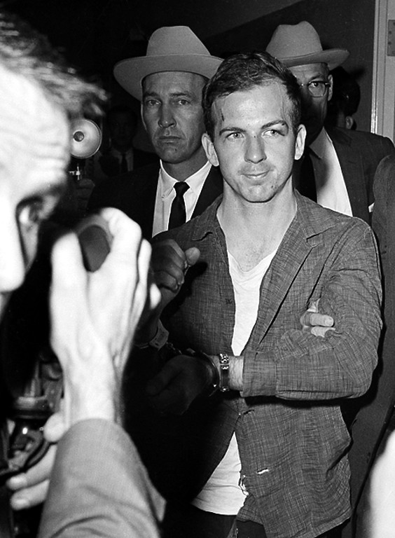 . Oswald is detained at police headquarters in Dallas, where he is held for questioning on Nov. 22, 1963. Fred Kaufman, Associated Press file