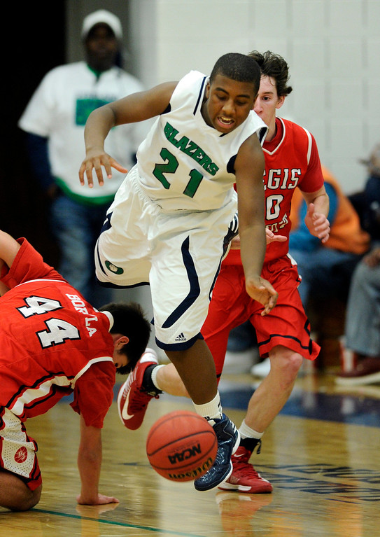 . Blazers guard Reginald Gibson (21) caused a turnover in the second half. The Overland High School boy\'s basketball team defeated Regis Jesuit 80-66 Tuesday night, December 11, 2012.  Karl Gehring/The Denver Post