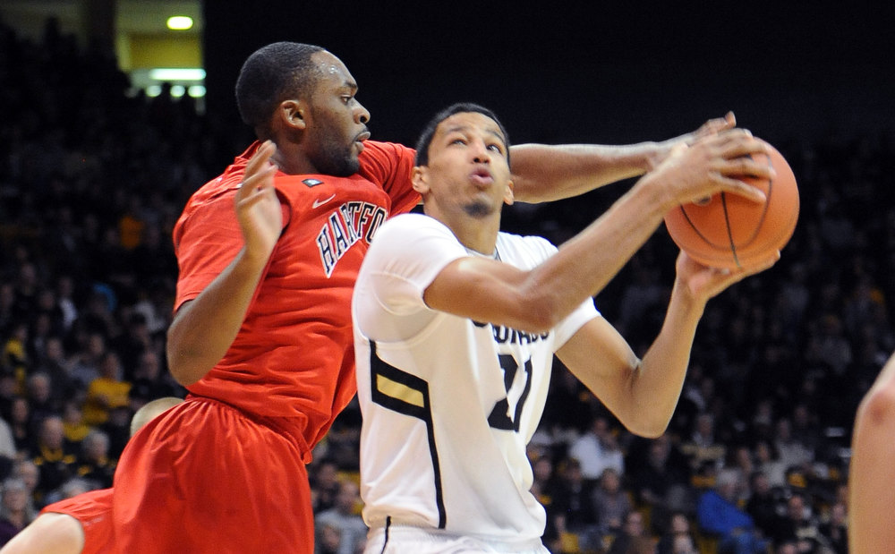 . Andre Roberson of CU drives past Wes Cole of Hartford, during the first half of the December 29, 2012 game in Boulder. (Cliff Grassmick / Daily Camera) December 29, 2012
