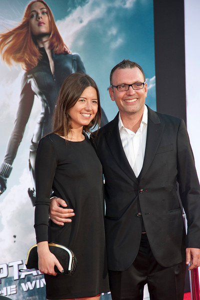 HOLLYWOOD, CA - MARCH 13: Composer Henry Jackman and Victoria de La Vega arrive at Marvel's 'Captain America: The Winter Soldier' premiere at the El Capitan Theatre onThursday,  March 13, 2014 in Hollywood, California. (Photo by Tom Sorensen/Moovieboy Pictures)