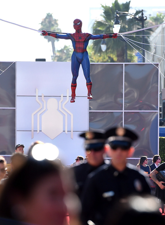 """. A Spider-Man figure hangs over the red carpet at the Los Angeles premiere of \""""Spider-Man: Homecoming\"""" at the TCL Chinese Theatre on Wednesday, June 28, 2017. (Photo by Jordan Strauss/Invision/AP)"""
