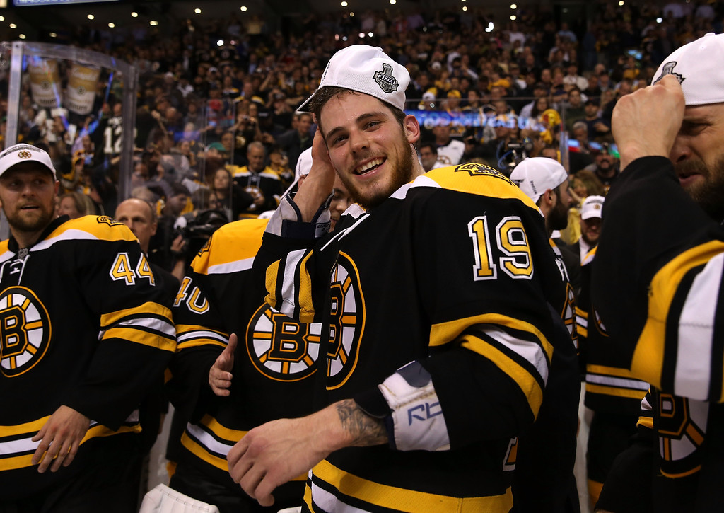 . BOSTON, MA - JUNE 07: Tyler Seguin #19 of the Boston Bruins puts on a Championship hat after defeating the Pittsburgh Penguins 1-0 in Game Four of the Eastern Conference Final during the 2013 NHL Stanley Cup Playoffs at the TD Garden on June 7, 2013 in Boston, United States.  (Photo by Bruce Bennett/Getty Images)