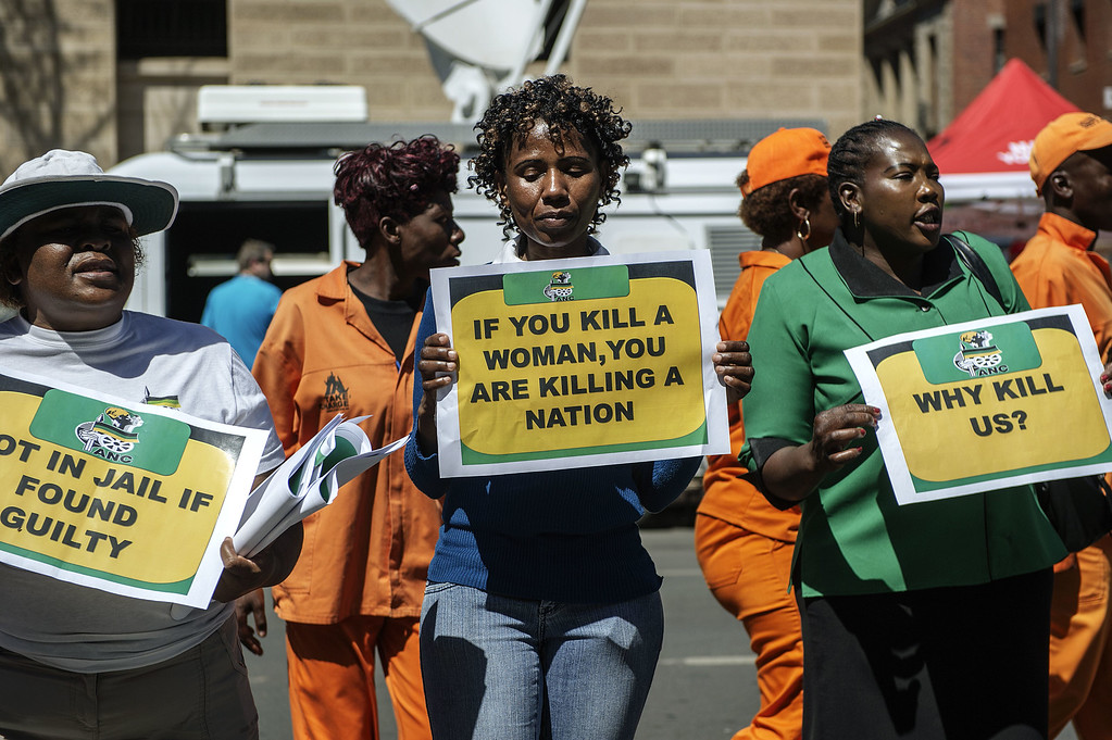 . African National Congress Women League members demonstrate outside the High Court in Pretoria on September 11, 2014, the verdict day in the murder trial of South African Paralympic athlete Oscar Pistorius. GIANLUIGI GUERCIAGIANLUIGI GUERCIA/AFP/Getty Images