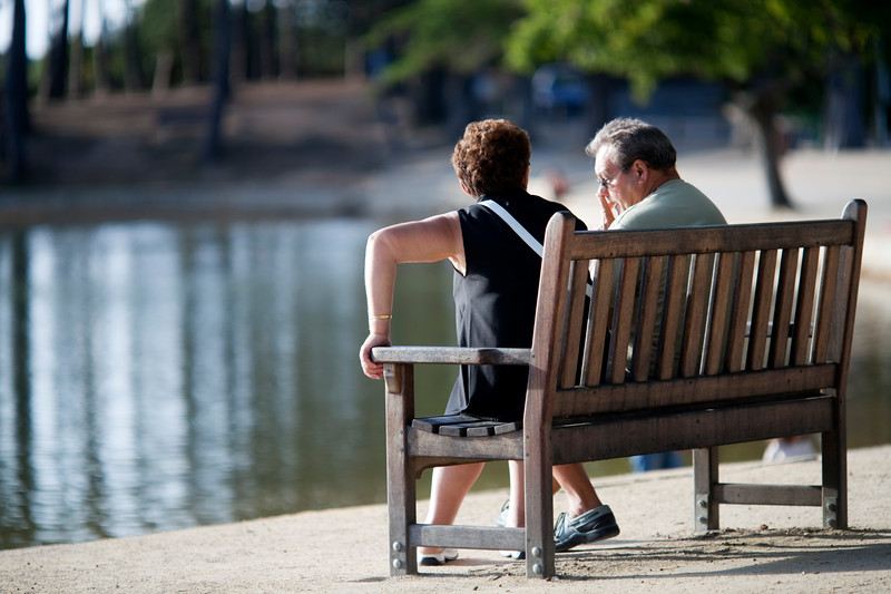 Senior couple sitting by the sea, Conleau island, town of Vannes, departament of Morbihan, region of Brittany, France