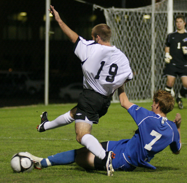 Midfielder Richard Wall (19) makes a shot on goal in the mens' soccer 2-1 win over UNC Asheville Wednesday night.