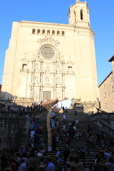 Tourists stand on the steps of Girona's cathedral