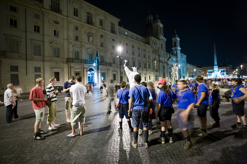 Boy scouts and street performers by night at Piazza Navona, Rome