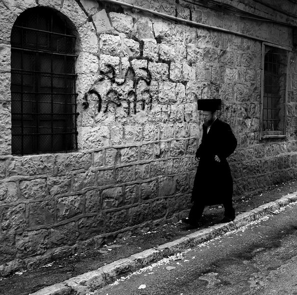 Haredim walking along the streets of Mea Shearim. 