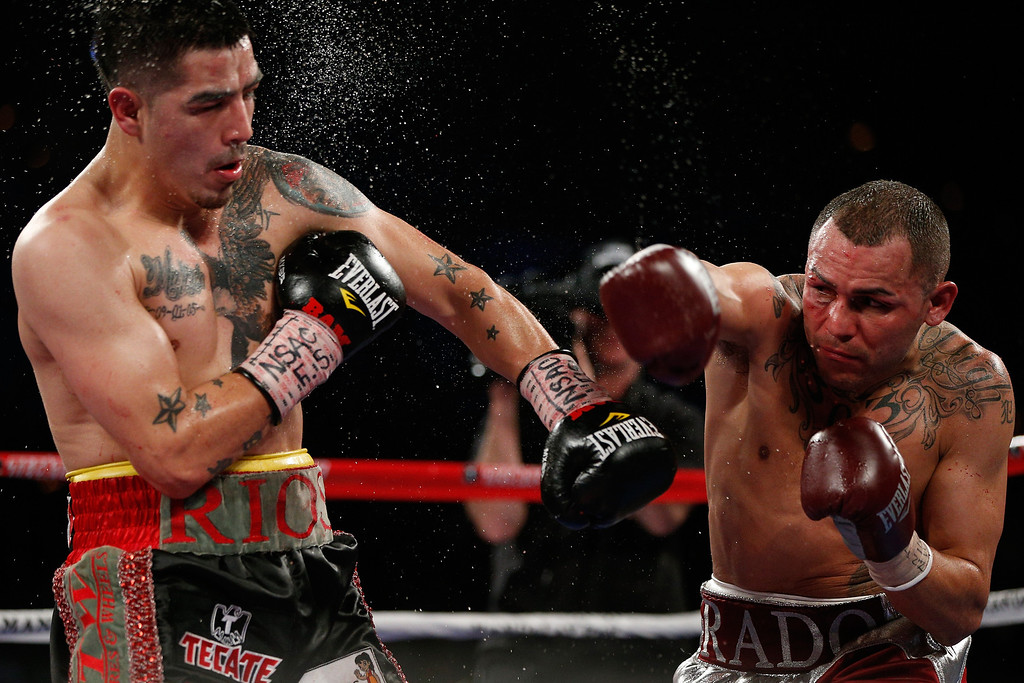 . 1. Mike Alvarado vs. Brandon Rios.  After falling to Rios nearly five months before, Alvarado took revenge in March of 2013, spraying �Bam Bam� Rios with punches and leaving him bloodied after 12 rounds to claim the WBO interim light welterweight title by unanimous decision.  (Photo by Josh Hedges/Getty Images)