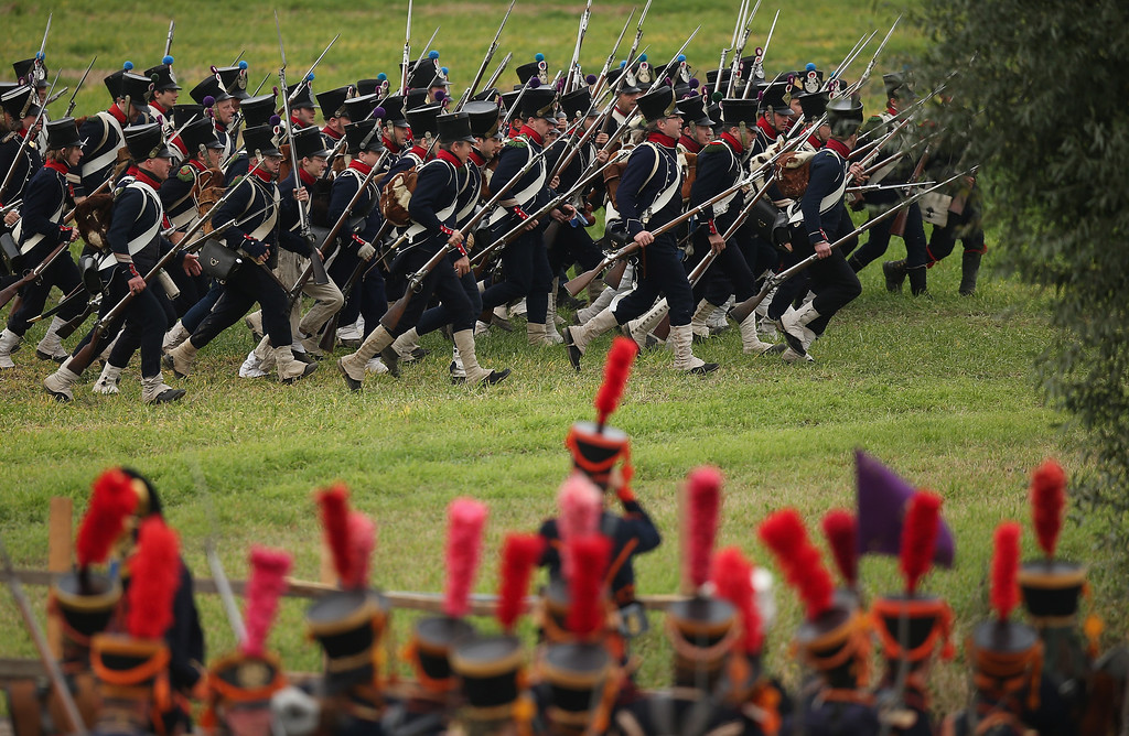. Historical society enthusiasts in the role of troops fighting under Napoleon begin their attack while re-enacting The Battle of Nations on its 200th anniversary on October 20, 2013 near Leipzig, Germany.  (Photo by Sean Gallup/Getty Images)