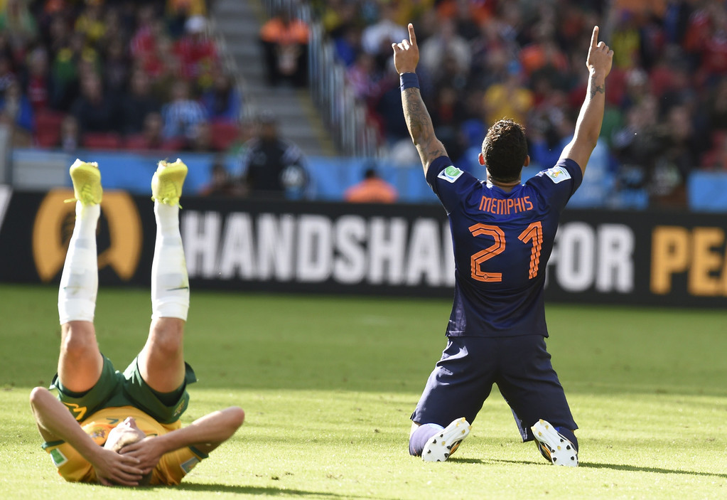 . Netherlands\' forward Memphis Depay (R) celebrates after a Group B football match between Australia and the Netherlands at the Beira-Rio Stadium in Porto Alegre during the 2014 FIFA World Cup on June 18, 2014.  JUAN BARRETO/AFP/Getty Images