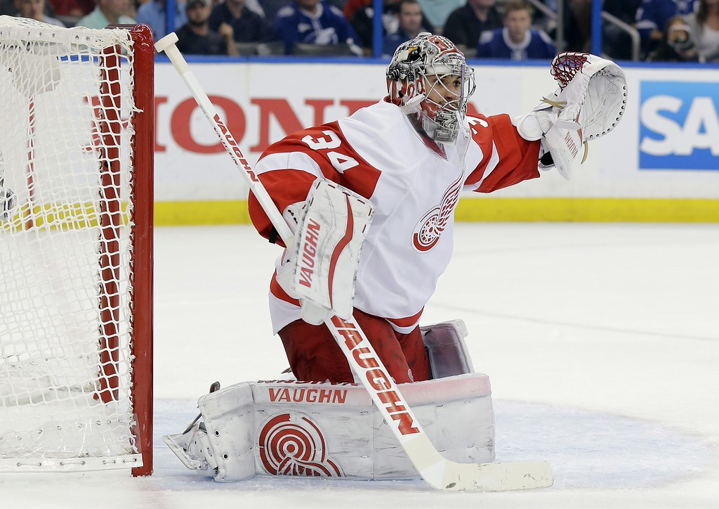 . Detroit Red Wings goalie Petr Mrazek (34), of the Czech Republic, reaches for a high shot by the Tampa Bay Lightning during the second period of Game 7 of a first-round NHL Stanley Cup hockey playoff series Wednesday, April 29, 2015, in Tampa, Fla. (AP Photo/Chris O\'Meara)
