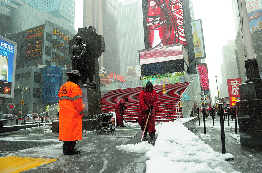 . Workers clear snow on Times Square  in New York, March 8, 2013.  AFP PHOTO/EMMANUEL DUNAND/AFP/Getty Images