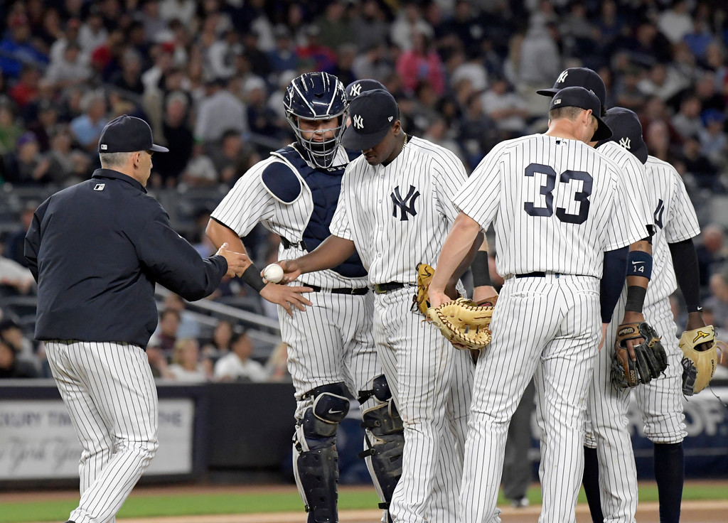 . New York Yankees manager Joe Girardi, left, takes the ball from New York Yankees starting pitcher Luis Severino as he leaves the game during the seventh inning of a baseball game Monday, Aug. 28, 2017, at Yankee Stadium in New York. (AP Photo/Bill Kostroun)