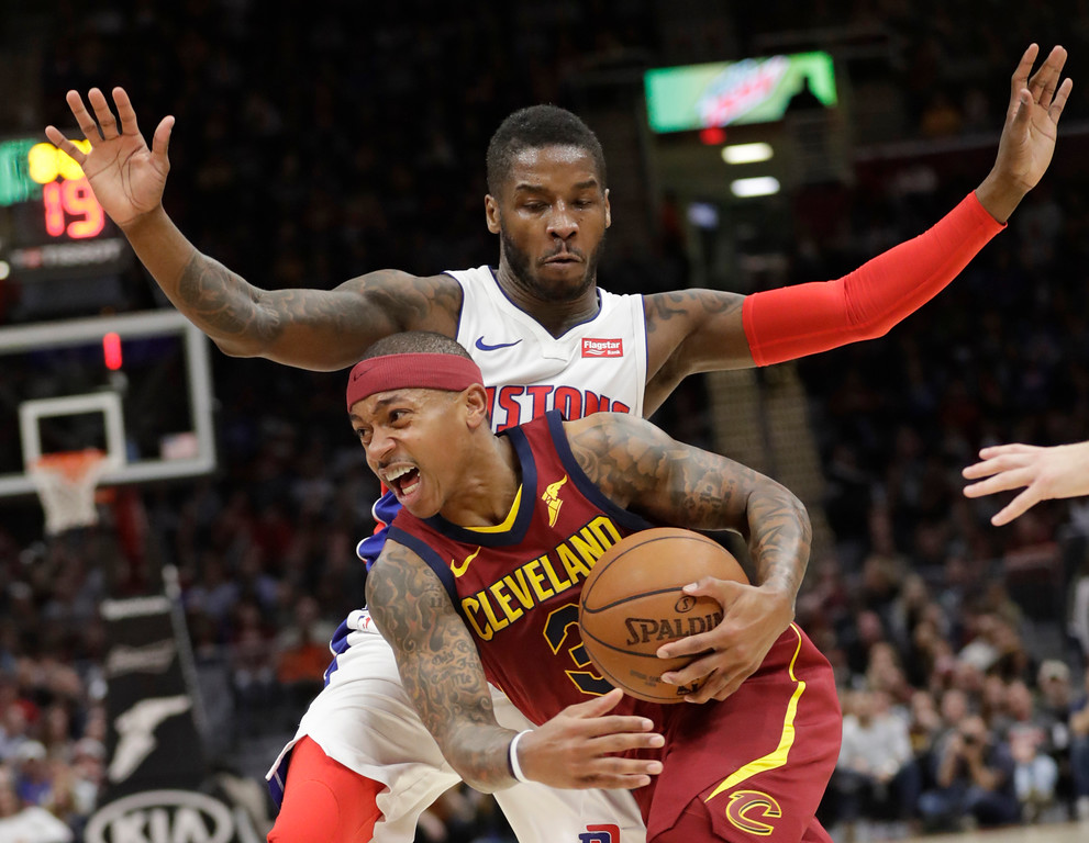 . Cleveland Cavaliers\' Isaiah Thomas, front, drives past Detroit Pistons\' Dwight Buycks in the first half of an NBA basketball game, Sunday, Jan. 28, 2018, in Cleveland. (AP Photo/Tony Dejak)