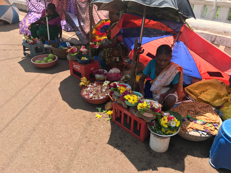Selling flowers to offer at Shri Mangesh temple