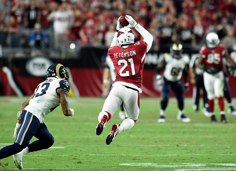 . Cornerback Patrick Peterson #21 of the Arizona Cardinals intercepts the football intended for wide receiver Chris Givens #13 of the St. Louis Rams in the fourth quarter at University of Phoenix Stadium on November 9, 2014 in Glendale, Arizona. The Cardinals won 31-14. (Photo by Norm Hall/Getty Images)