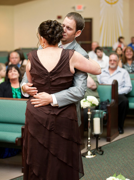 Groom hugging mom at seat.jpg