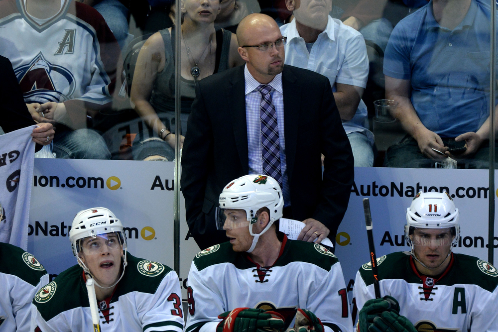 . Mike Yeo of the Minnesota Wild watches intently as his team battles the Colorado Avalanche during the second period of action. The Colorado Avalanche hosted the Minnesota Wild in the first round of the NHL playoffs at the Pepsi Center on Thursday, April 17, 2014. (Photo by Karl Gehring/The Denver Post)
