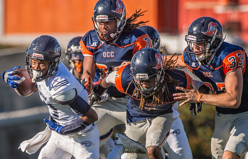 Orange Coast College defense attempts to track down running back from Fullerton Junior College