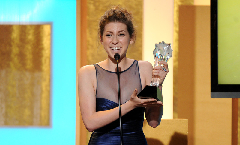 """. Eden Sher accepts the award for best supporting actress in a comedy series for \""""The Middle\"""" at the Critics\' Choice Television Awards in the Beverly Hilton Hotel on Monday, June 10, 2013, in Beverly Hills, Calif. (Photo by Frank Micelotta/Invision/AP)"""