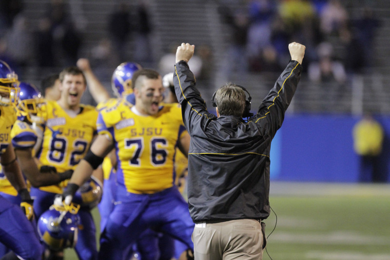 . San Jose State Spartans head coach Mike MacIntyre celebrates after his defense stopped Brigham Young on downs in the 4th quarter of an NCAA college football game in San Jose, Calif., Saturday, Nov. 17, 2012. (AP Photo/John Storey)