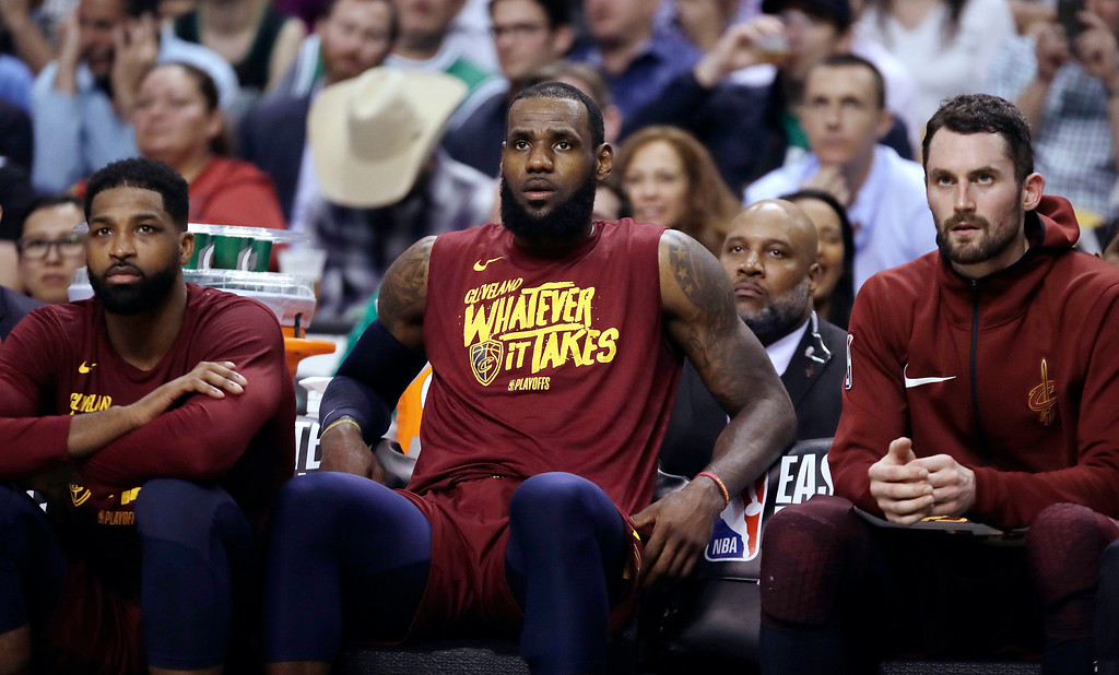. Cleveland Cavaliers forwards Jeff Green, left, and LeBron James, center, sit on the bench with center Kevin Love during the second half in Game 2 of the NBA basketball Eastern Conference finals against the Boston Celtics, Tuesday, May 15, 2018, in Boston. (AP Photo/Charles Krupa)