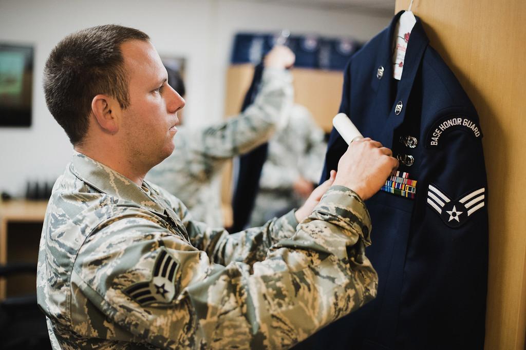 . Senior Airman Joseph Trujillo preps his ceremonial uniform at March Air Reserve Base in Riverside, Calif. on Monday, May 18, 2015. (Photo by Watchara Phomicinda/ Los Angeles Daily News)