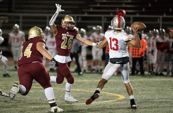 11/01/19 Wesley Bunnell | StaffrrNew Britain football was defeated 17-14 by Conard in OT in a game played on Friday night at Veterans Stadium. Isaiah Medina (28) pressures the Conard QB.