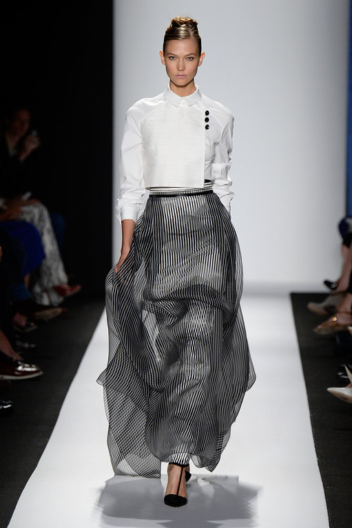 . Model Karlie Kloss walks the runway at the Carolina Herrera fashion show during Mercedes-Benz Fashion Week Spring 2014 at The Theatre at Lincoln Center on September 9, 2013 in New York City.  (Photo by Frazer Harrison/Getty Images for Mercedes-Benz Fashion Week Spring 2014)