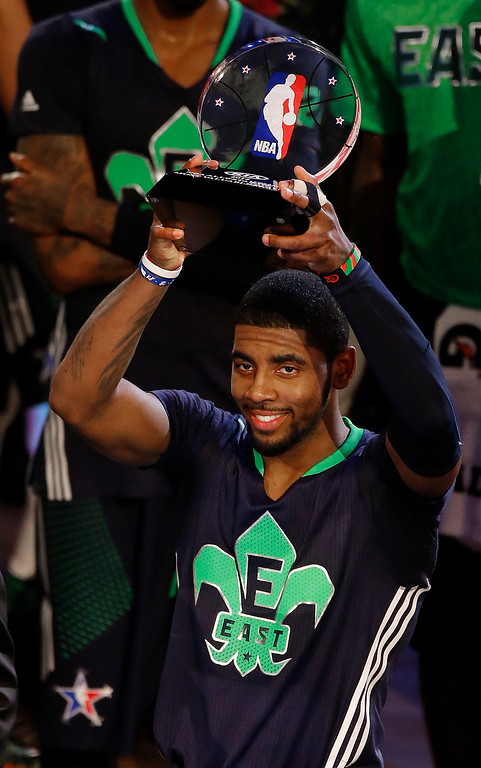 . East Team\'s Kyrie Irving, of the Cleveland Cavaliers holds the All Star MVP trophy after the NBA All Star basketball game, Sunday, Feb. 16, 2014, in New Orleans.(AP Photo/Bill Haber)