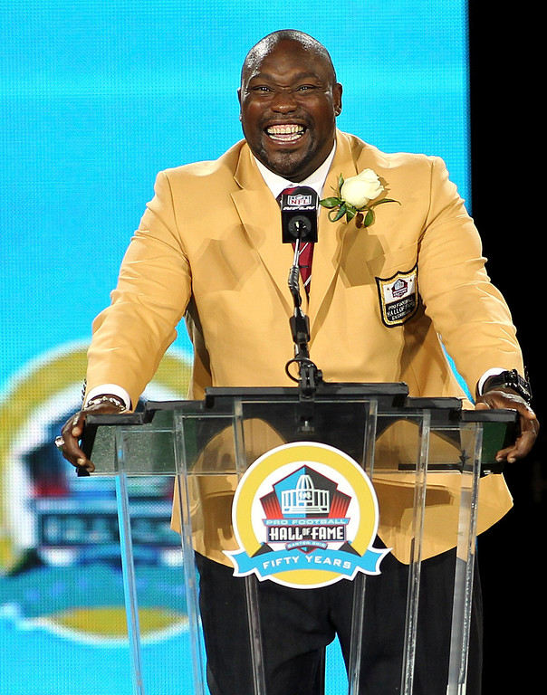 . New inductee Warren Sapp laughs as he talks during his acceptance into the NFL Pro Football Hall of Fame in Canton, Ohio August 3, 2013. REUTERS/Aaron Josefczyk