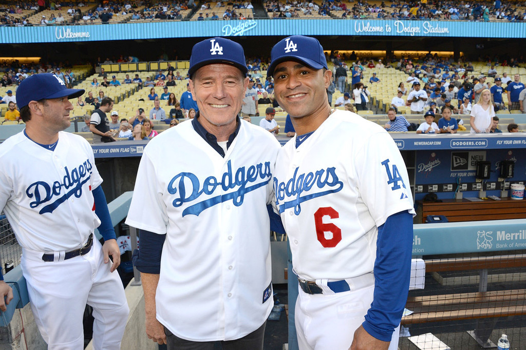 . In this handout photo provided by the Los Angeles Dodgers, Bryan Cranston and Jerry Hairston, Jr. attend the Cincinnatti Reds versus Los Angeles Dodgers game at Dodger Stadium on July 26, 2013 in Los Angeles, California.  (Photo by Jon Soohoo/Los Angeles Dodgers via Getty Images)