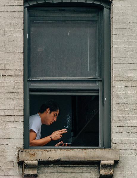 Smoker in his window.jpg