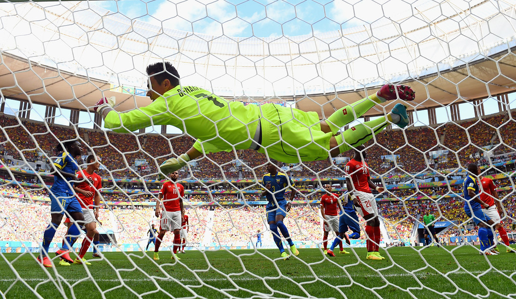 . Diego Benaglio of Switzerland dives in vain as Enner Valencia of Ecuador (not pictured) scored his team\'s first goal during the 2014 FIFA World Cup Brazil Group E match between Switzerland and Ecuador at Estadio Nacional on June 15, 2014 in Brasilia, Brazil.  (Photo by Stu Forster/Getty Images)